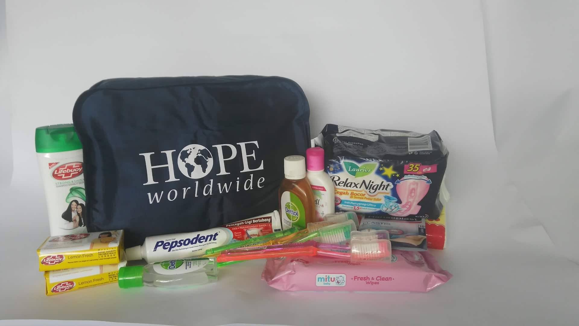 Hygiene Kit (for a woman)Shampoo  Soft Soap  Women's razor  Shave Cream  Toothbrush  Toothpaste  Deodorant  Mouthwash  Brush  Feminine Pads  Towel  Large printed Ziploc bag